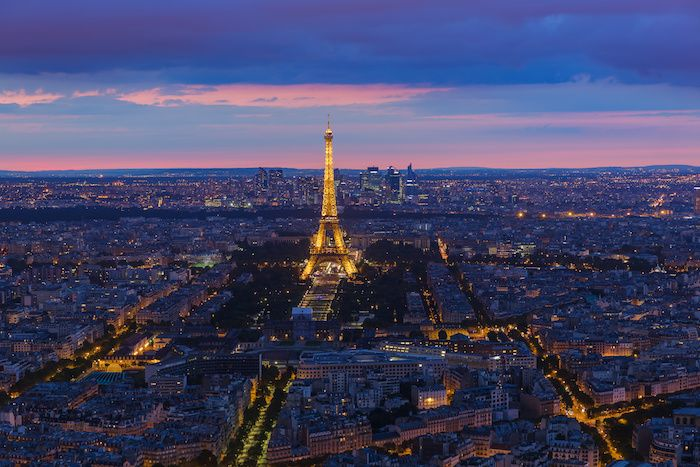 Cityscape of Paris France - Eiffel Tower at night lit up