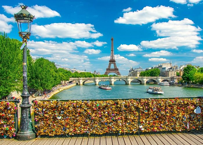 "Sunny day on ""Pont des arts"" at Paris with an amazing view of Tower Eiffel"