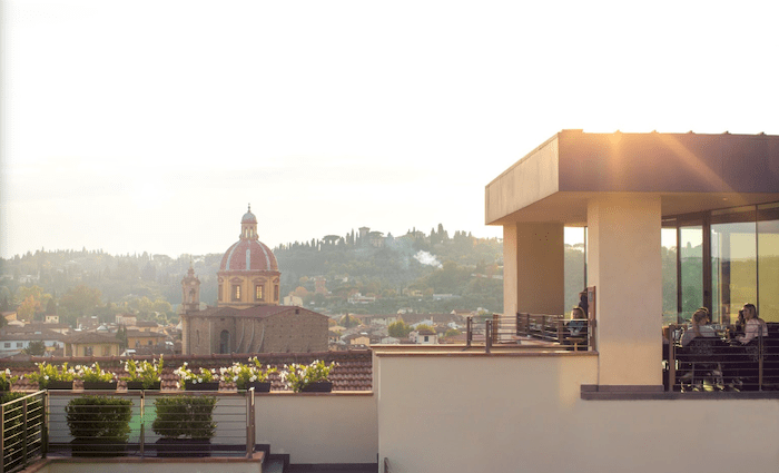 Se Sto on Arno Rooftop Florence
